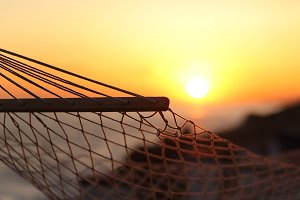 Close up of a hammock on the beach at sunset.jpg