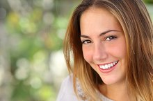 Close up of a beautiful woman with a whiten perfect smile.jpg