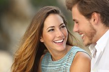 Funny couple laughing with a white perfect smile.jpg