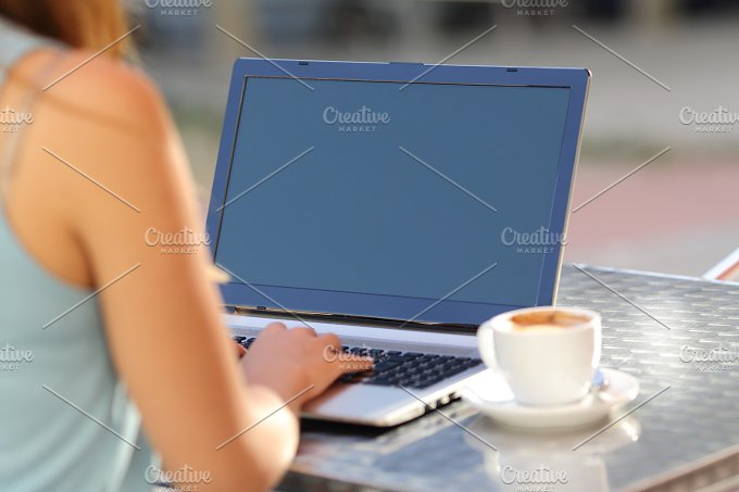 Girl typing on a laptop and showing screen.jpg - Technology