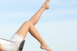 Perfect woman waxing hair removal legs swinging.jpg