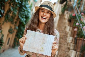 smiling stylish traveller woman with