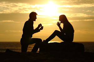 Proposal on the beach with a man asking for marry at sunset.jpg