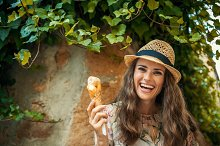 happy young tourist woman in old Eur