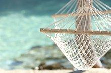 Travel concept with a hammock in a tropical beach.jpg