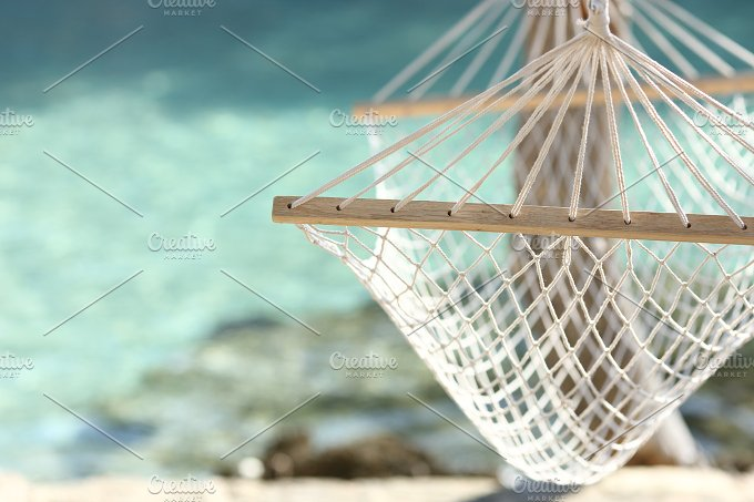 Travel concept with a hammock in a tropical beach.jpg - Holidays
