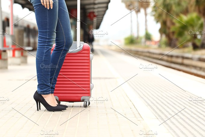 Traveler tourist waiting in a train station.jpg - Transportation