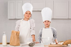 brother and sister in aprons and che