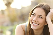 Woman with white teeth thinking and looking sideways.jpg