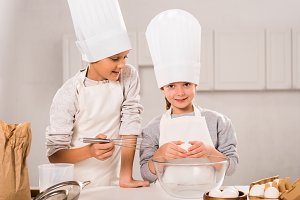 little children in aprons and chef h