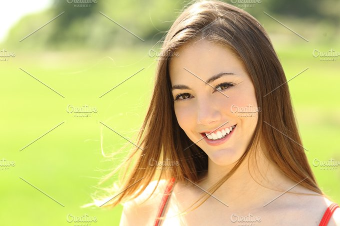 Woman with perfect teeth and smile looking you.jpg - Beauty & Fashion