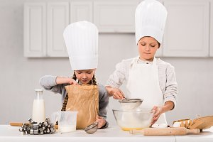 adorable children in aprons and chef