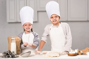 sister and brother in chef hats havi