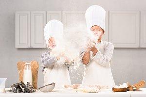 happy children in chef hats having f