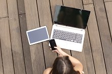 Woman using multiple devices phone laptop and tablet.jpg