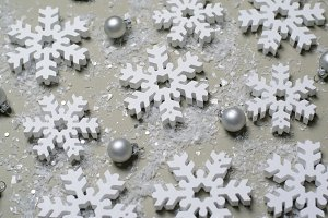 White Snowflakes on Beige Background