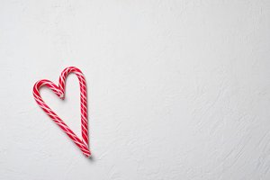 Candy Canes Heart-Shaped on White Ba