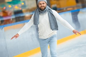 bearded man in knitted hat and sweat