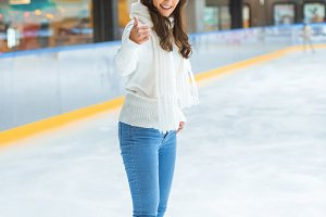 young happy woman showing thumb up w