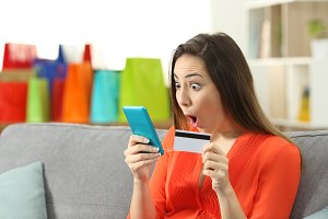 Amazed woman finding online offers