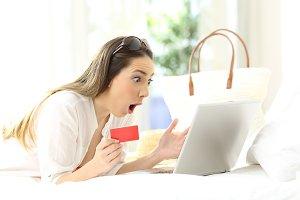 Amazed woman buying on line