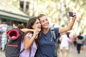 Backpacker friends taking selfie