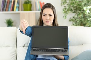 Angry woman showing a blank laptop
