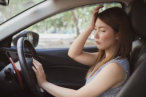 Stressed of asian woman driver sitti