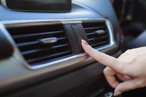 Close up finger hitting car emergenc