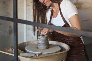 Female artisan working inside of her