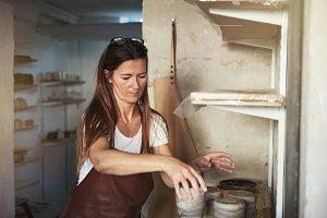 Female artisan at work in her creati