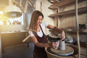 Artisan making a vase in her creativ