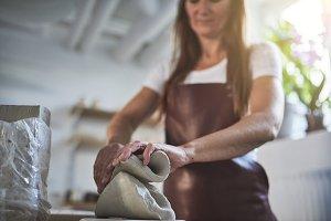 Creative artisan weighing blocks of