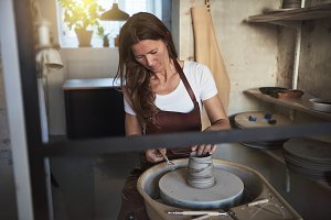 Artisan creatively shaping clay on a