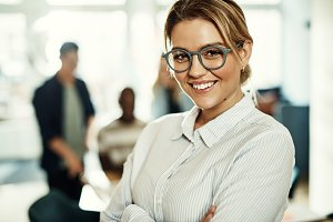 Smiling young businesswoman standing