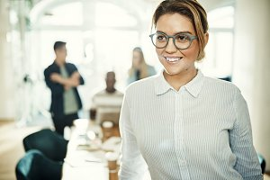 Smiling young businesswoman at work