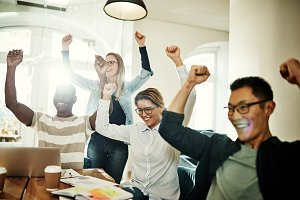 Ecstatic group of diverse coworkers