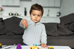 child playing with toy airplane in l