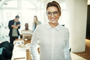 Smiling young businesswoman wearing