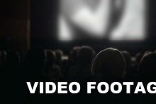 People watching film in the cinema