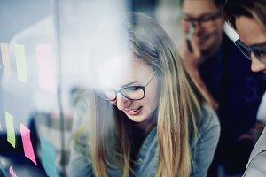 Smiling businesswoman brainstorming