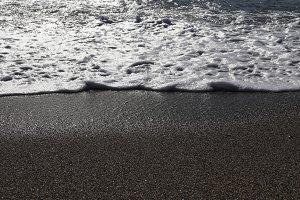 Sand beach with wave foam