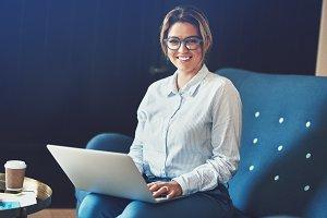 Smiling female entrepreneur sitting