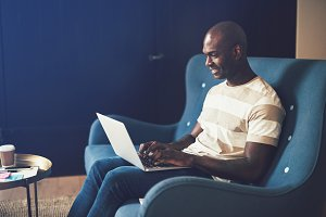 Young African entrepreneur sitting o