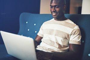 Smiling African entrepreneur sitting