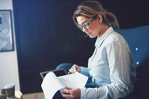 Young female entrepreneur reading pa