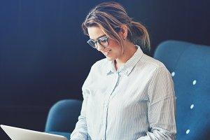 Smiling female entrepreneur working