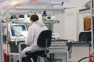Electronics engineers working in lab