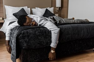 exhausted african american man sleep