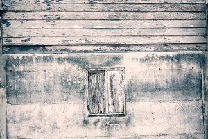 Wooden window on cement wall